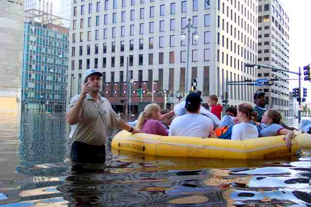 ALL LOADED: Paul LaCoste holds life raft   outside Hibernia Center / Photo: Bruce Martin