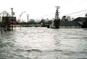NEARLY UNDER WATER: This Slidell office (at right) appears to be sinking into the sea / Photo: Tommy Doiron