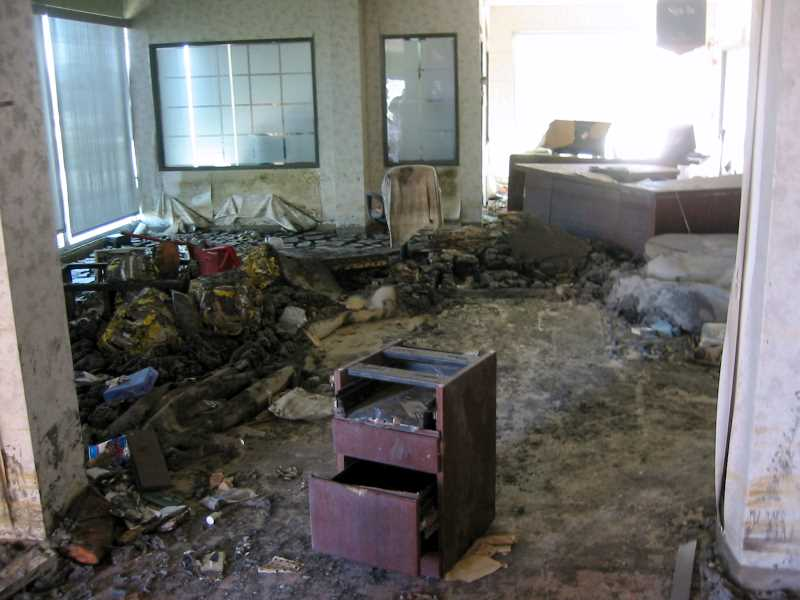 Mud and debris covers banking office floor / All photos: Russ Hoadley