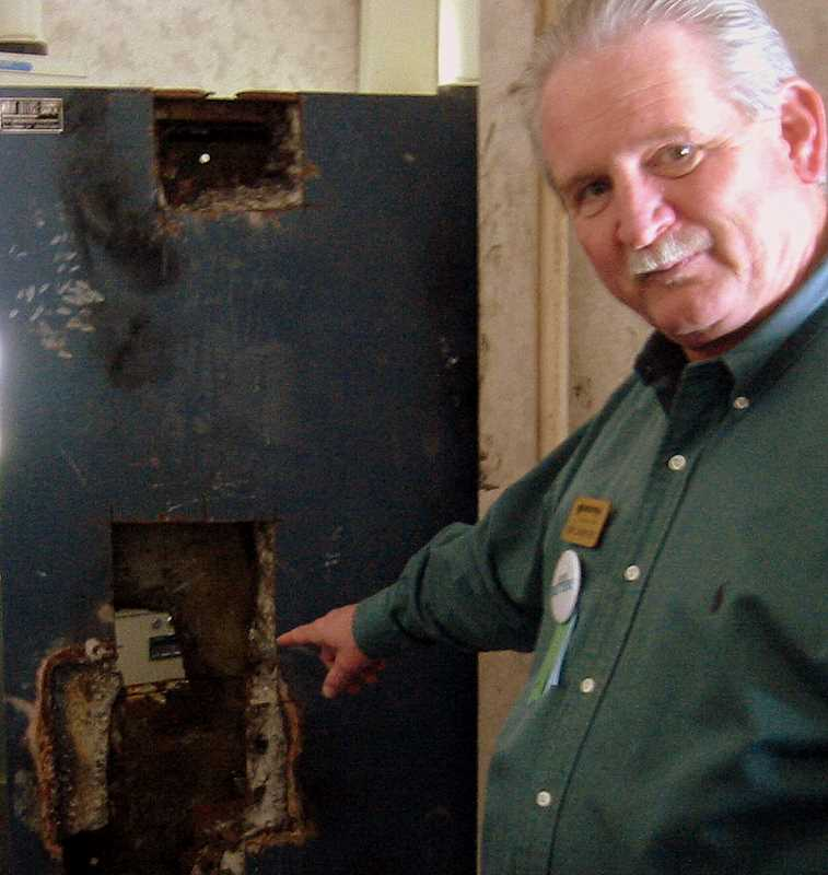 Ron Samford points to ruined vault, drilled and cleaned out by maintenance crews