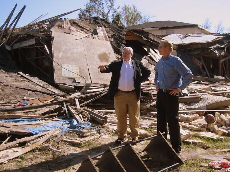 Myles Reidy describes to Rich Fairbank how the barge came through the levee