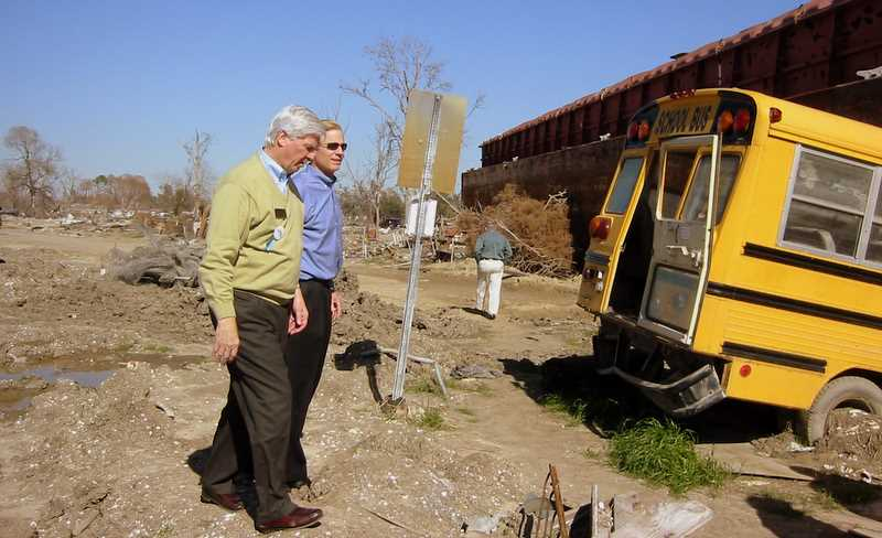 Herb Boydstun and Rich Fairbank walk near huge barge high and dry next to Industrial Canal levee