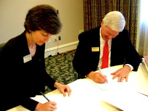 SIGNING THE PAPERS: Cathy Chessin and Herb Boydstun seal the deal / Photo: Russ Hoadley