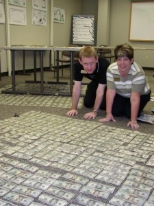 DRYING OUT CASH: Louis Lusignan and Janic Nichols, on hands and knees, work with hundreds of bills / Photo: Unknown