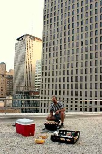 GRILL CHEF: Robert Manint fires up the BBQ on the roof / Photo: Skip Federico